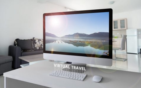 Computer,With,A,Landscape,On,The,Screen.,Virtual,Travel